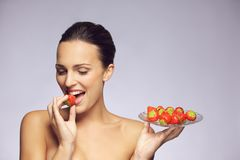 Gorgeous woman eating strawberry Stock Images
