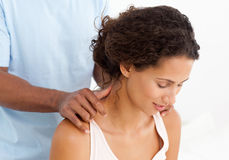 Gorgeous woman enjoying a back massage Royalty Free Stock Image