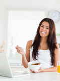 Gorgeous woman enjoying a bowl of cereals Stock Image