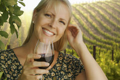 Gorgeous Woman Enjoying a Glass of Wine at the Vineyard Royalty Free Stock Photo