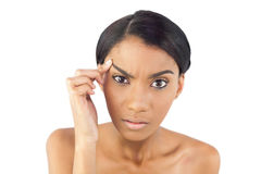 Gorgeous woman examining her eyebrow Royalty Free Stock Photography