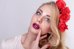 Gorgeous woman with flowers in head on grey background Royalty Free Stock Images