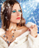 Gorgeous woman in fur on vintage background with rays Stock Photo