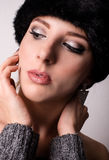 Gorgeous Woman with Furry Hat Looking Down Royalty Free Stock Photography