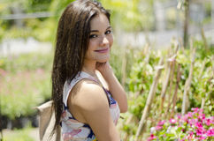 Gorgeous woman in a garden Royalty Free Stock Images