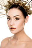 Gorgeous woman in golden headpiece and stylish makeup isolated on white Stock Photo
