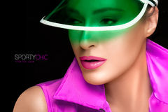 Gorgeous Woman in Green Sun Visor and Colorful Sportswear Royalty Free Stock Photography
