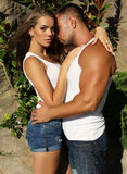 Gorgeous woman and handsome man embracing in garden Stock Image