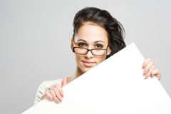 Gorgeous woman holding blank white banner. Stock Image