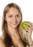 Gorgeous woman holding a green apple Stock Images