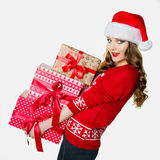 Gorgeous woman holding loads of heavy presents Royalty Free Stock Image