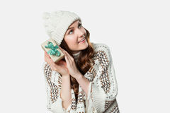 Gorgeous woman holding tiny present Stock Photography
