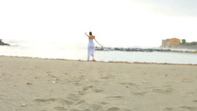 Gorgeous woman inviting towards the beach stock video footage