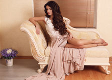 Gorgeous woman with long dark hair in elegant dress Stock Images