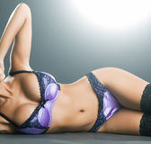 Gorgeous woman with long hair in purple lingerie Royalty Free Stock Images