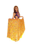 Gorgeous woman in long yellow skirt. Stock Images