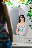 Gorgeous woman looking into the mirror Stock Photos