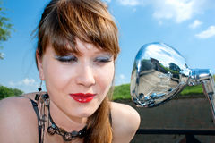 Gorgeous woman looking on motorbikes rear view Royalty Free Stock Images