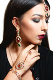 Gorgeous woman with luxurious jewelry close-up. Portrait of beautiful indian princess with ceremonial makeup and finery. Luxury, wealth, pleasure concept Stock Photos
