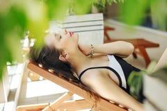 Gorgeous woman lying on the deckchair. Gorgeous lady lying on the deckchair Royalty Free Stock Image