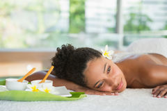 Gorgeous woman lying on massage table with salt treatment on back Stock Photo