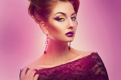 Gorgeous woman with make up and hairstyle in studio Stock Photos