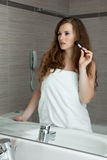 Gorgeous woman makeup in bathroom Royalty Free Stock Photography
