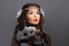 Gorgeous woman in masquerade mask Royalty Free Stock Photos