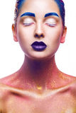 Gorgeous woman with multicolor make up and healthy skin in studi Stock Photography