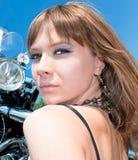 Gorgeous woman near by motorbike Stock Photos