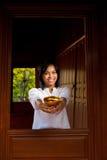 Gorgeous Woman Offering Thai Bowl Stock Photo