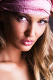 Gorgeous woman in a pink hat. Close-up portrait of a beautiful woman in a pink hat royalty free stock photo