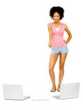 Gorgeous woman pointing towards laptop Stock Photography
