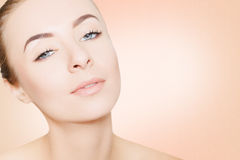 Gorgeous woman portrait cleaning skin over pink background Royalty Free Stock Photography