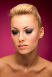 Gorgeous woman portrait with perfect makeup, smokey eyes, full l. Ips over colorful background Royalty Free Stock Image