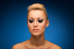 Gorgeous woman portrait with perfect makeup, smokey eyes, full l Stock Image
