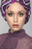 Gorgeous woman portrait in purple clothes Royalty Free Stock Photos