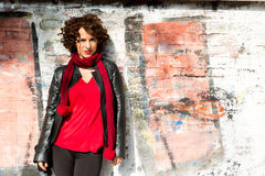 Gorgeous woman posing with graffiti Stock Photography