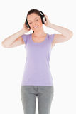 Gorgeous woman posing with headphones Stock Image