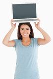Gorgeous woman posing with her laptop Royalty Free Stock Images