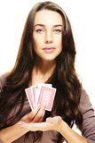 Gorgeous woman presenting poker cards Stock Photos