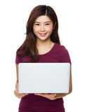 Gorgeous woman relaxing with her laptop Stock Image