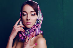 Gorgeous woman in retro style, with elegant silk scarf. Fashion studio portrait of beautiful gorgeous woman in retro style, with elegant silk scarf stock photos