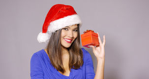 Gorgeous woman in Santa hat holding gift Stock Image