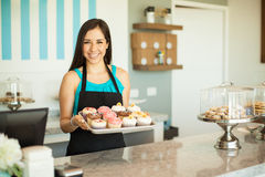 Gorgeous woman selling cupcakes Stock Image