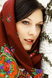 Gorgeous woman in shawl. Gorgeous russian woman in shawl standing by the birch Royalty Free Stock Photography