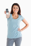Gorgeous woman showing her mobile phone Royalty Free Stock Image