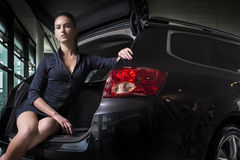 Gorgeous woman sitting in back of car Stock Photo