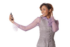 Pretty woman taking picture of herself. Stock Photo