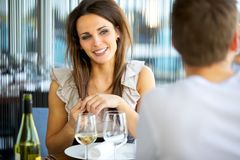Gorgeous Woman Smiling at Her Date Stock Photo